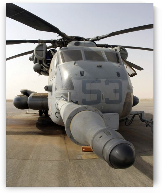 A CH-53E Super Stallion helicopter sitting on the flight line at Al Asad Air Base Iraq.  by StocktrekImages