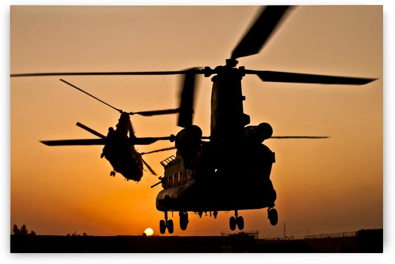 Two Royal Air Force CH-47 Chinooks take off from headquarters in Afghanistan. by StocktrekImages