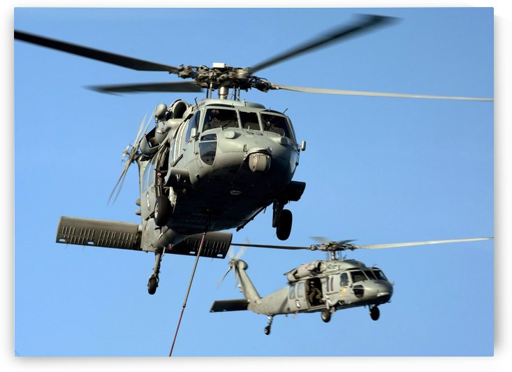 MH-60S Sea Hawk helicopters in flight. by StocktrekImages