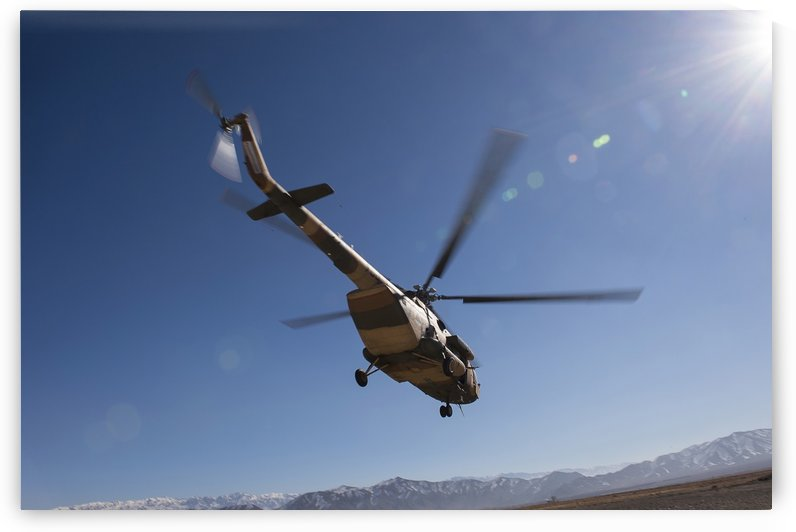 An Afghan Air Force Mil Mi-17 helicopter over Afghanistan. by StocktrekImages