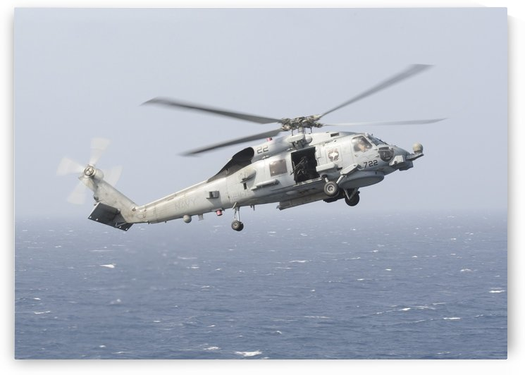 An MH-60R Sea Hawk helicopter prepares to land. by StocktrekImages