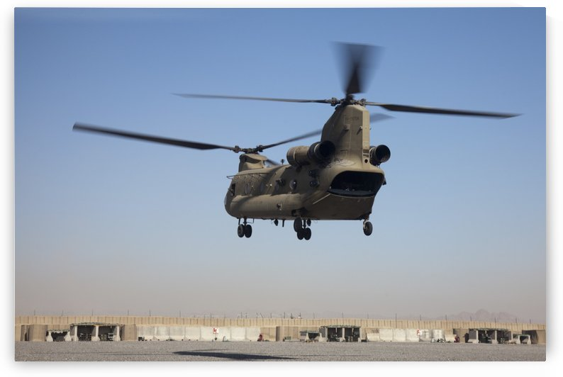 A CH-47 Chinook helicopter prepare to land. by StocktrekImages