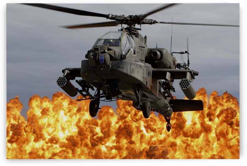An AH-64D Apache Longbow during a combined arms demonstration. by StocktrekImages