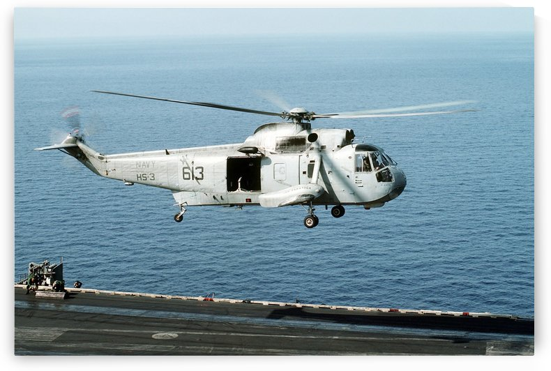 An SH-3H Sea King helicopter prepares to land on USS Saratoga. by StocktrekImages