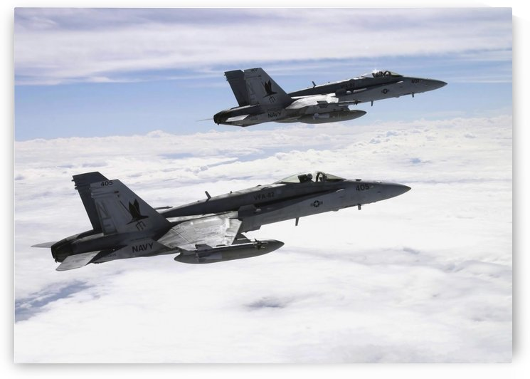 Two F-A-18C Hornets fly over the Pacific Missile Range Facility. by StocktrekImages