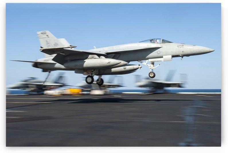 An F-A-18E Super Hornet lands on the flight deck of USS Harry S. Truman. by StocktrekImages