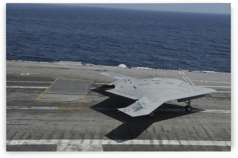 An X-47B Unmanned Combat Air System makes an arrested landing. by StocktrekImages