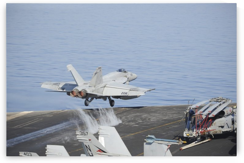 An F-A-18E Super Hornet launches from USS Nimitz. by StocktrekImages