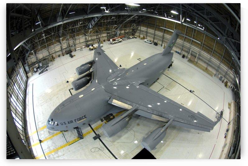 A C-17 Globemaster III sits in Hangar 4. by StocktrekImages