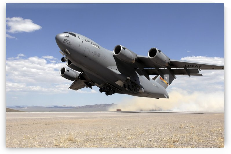 A C-17 Globemaster departs from the Tonopah runway. by StocktrekImages