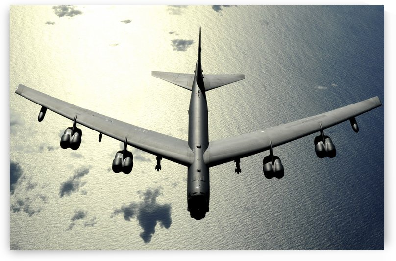 A B-52 Stratofortress in flight over the Pacific Ocean. by StocktrekImages