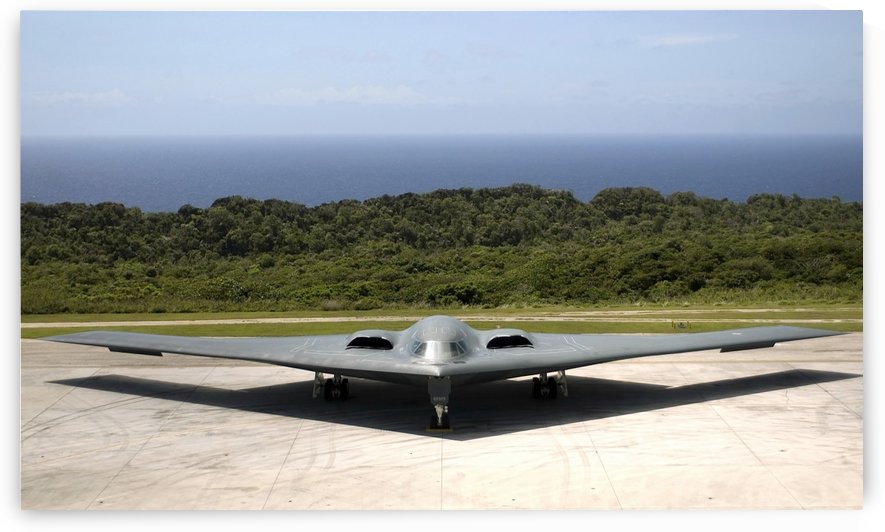 A B-2 Spirit stealth bomber waits on the flightline. by StocktrekImages