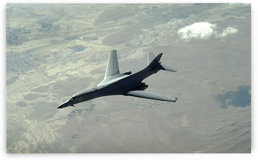 A U.S. Air Force  B-1B Lancer on a combat patrol over Afghanistan. by StocktrekImages