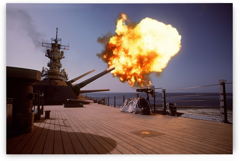 Battleship USS Wisconsin fires one of the Mark 7 16-inch-50-caliber guns. by StocktrekImages