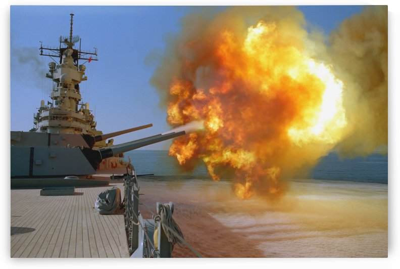 Battleship USS Wisconsin fires a round from one of the Mark 7 16-inch-50-caliber guns. by StocktrekImages