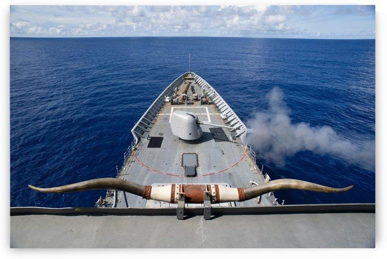 USS Cowpens fires its Mk 45 Mod 2 gun. by StocktrekImages