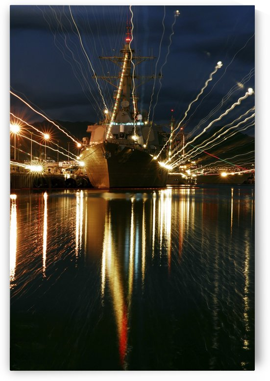 Holiday lights shine from guided-missile destroyer USS Russell. by StocktrekImages