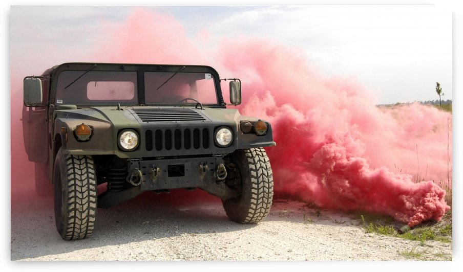 Red smoke billows out onto a humvee. by StocktrekImages