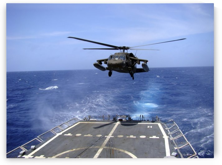 An Army UH-60 Black Hawk helicopter landing aboard the USS Underwood off the coast of Honduras. by StocktrekImages