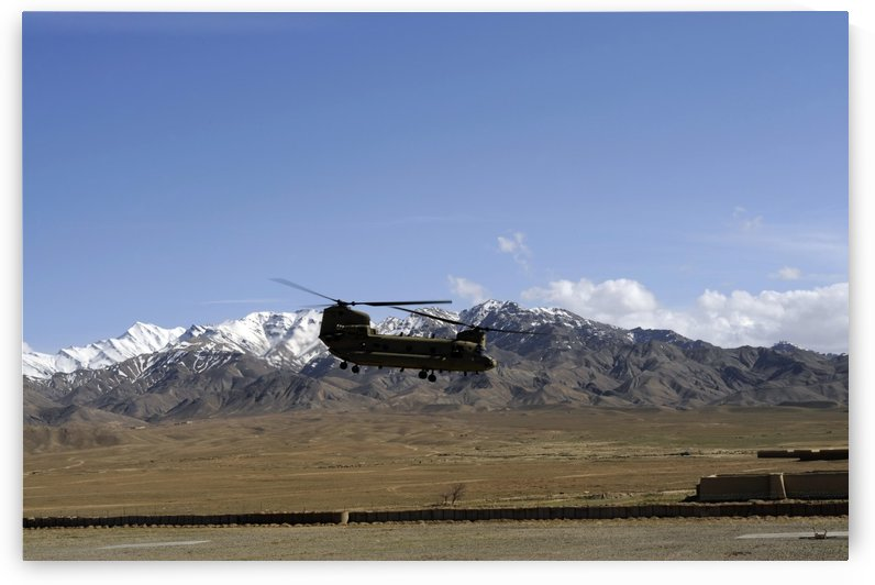 A CH-47 Chinook takes off from Forward Operating Base Gardez. by StocktrekImages