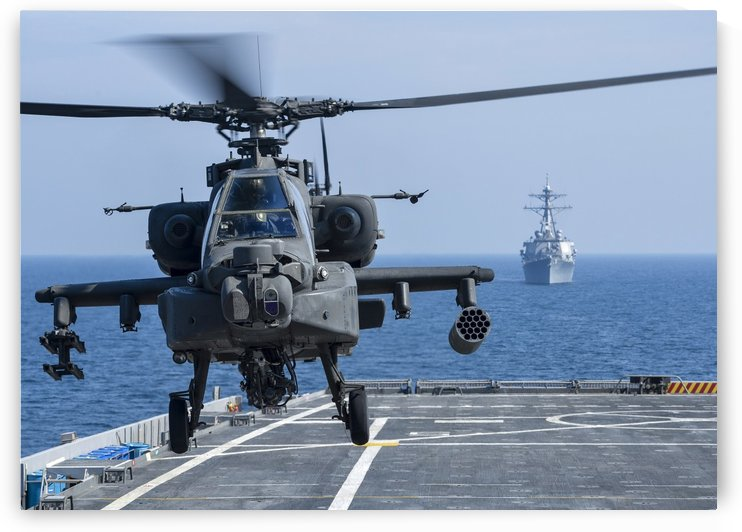 An Army AH-64D Apache helicopter takes off from USS Ponce. by StocktrekImages