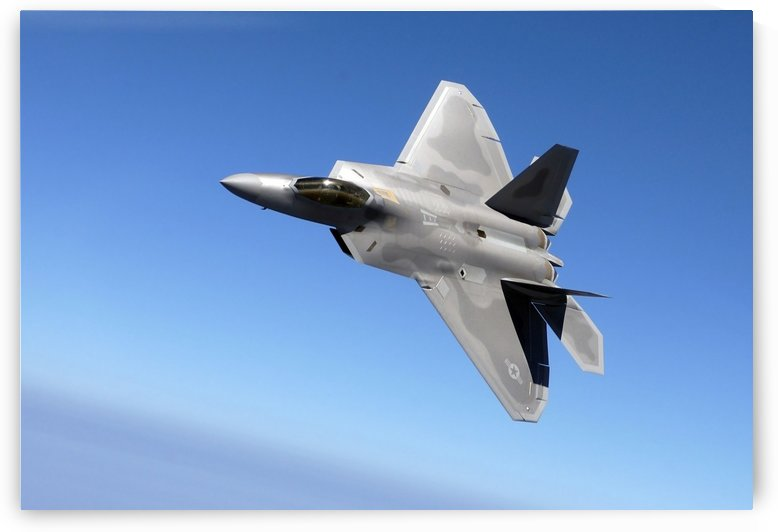 An F-A-22 Raptor banks during a training sortie. by StocktrekImages