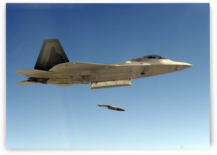 An F-22A Raptor drops a GBU-32 bomb. by StocktrekImages
