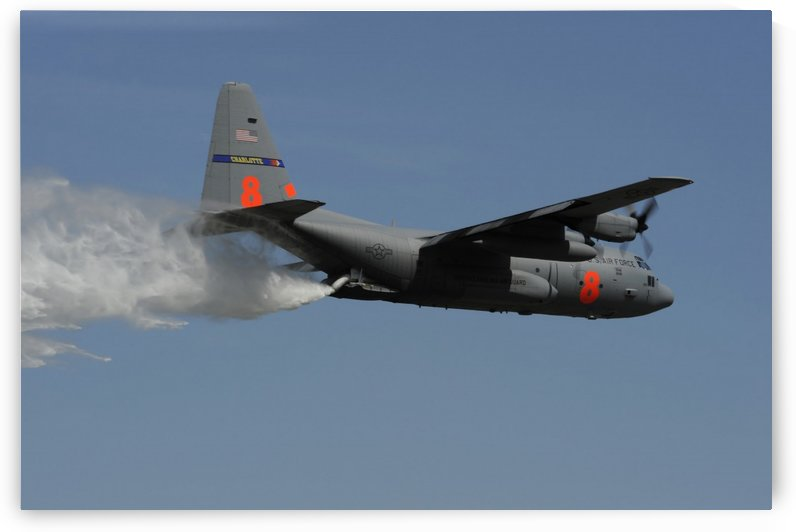 A U.S. Air Force C-130 Hercules releases its payload of water during training over South Carolina. by StocktrekImages