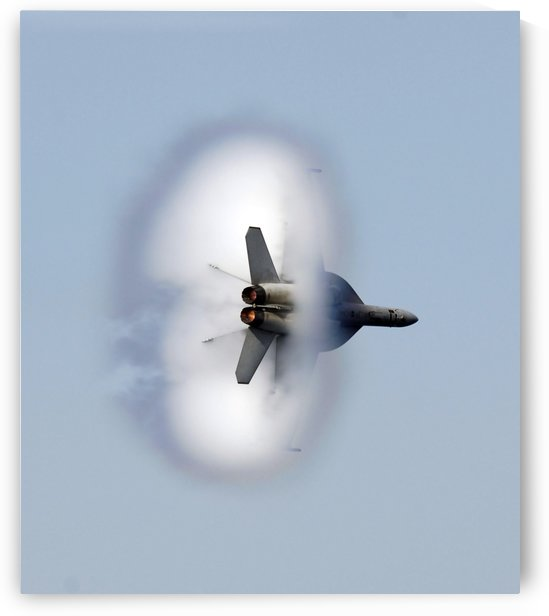An F-A-18F Super Hornet completes a super-sonic flyby. by StocktrekImages