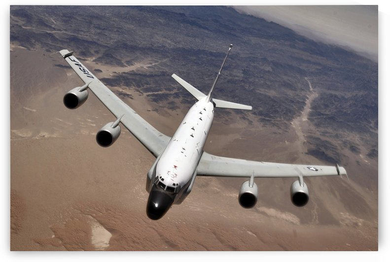 An RC-135 Rivet Joint reconnaissance aircraft moves into position to refuel. by StocktrekImages