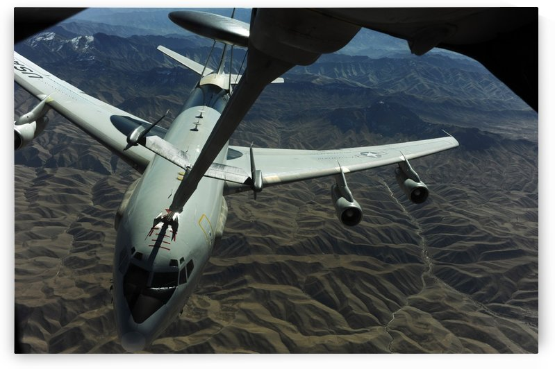 A U.S. Air Force E-3 Sentry aircraft refueling from a KC-10 Extender. by StocktrekImages