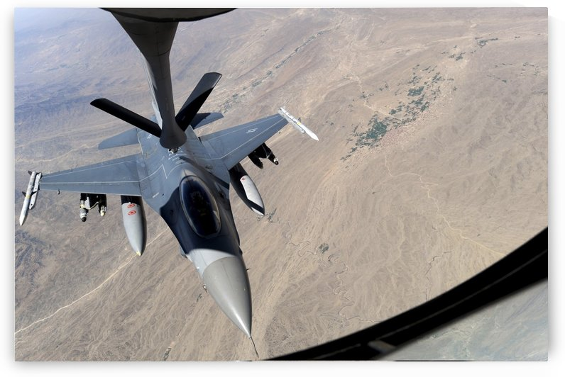 An F-16 Fighting Falcon receives fuel from a KC-135 Stratotanker. by StocktrekImages