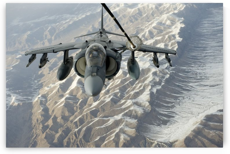 An A-V-8B Harrier receives fuel over Afghanistan from a KC-10 Extender. by StocktrekImages