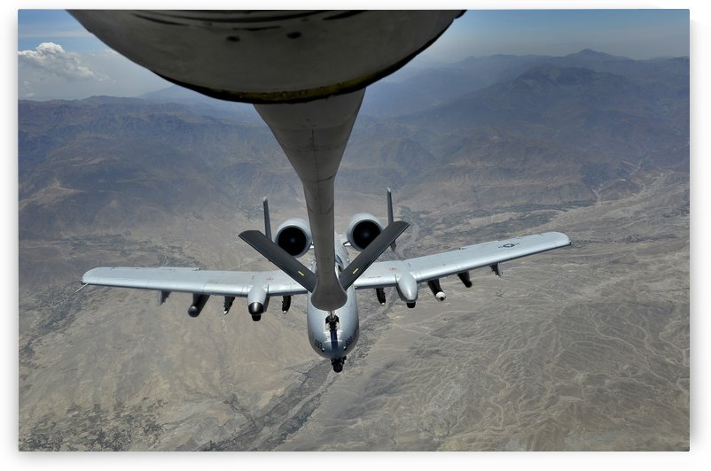 A U.S. Air Force A-10 Thunderbolt is refueled over Afghanistan. by StocktrekImages
