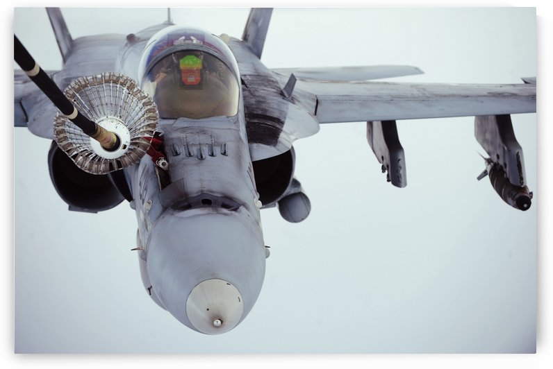 An F-A-18 Super Hornet receives fuel over Afghanistan. by StocktrekImages