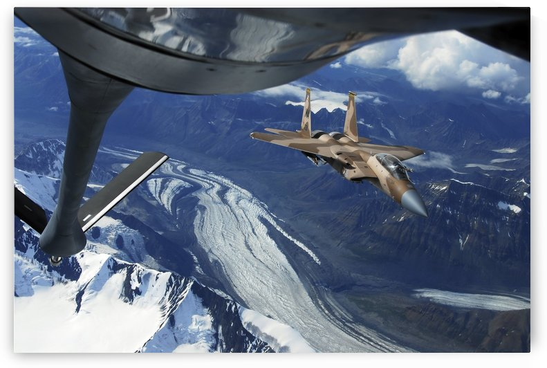 A U.S. Air Force F-15C Eagle positioning itself behind a KC-135R Stratotanker over Alaska. by StocktrekImages