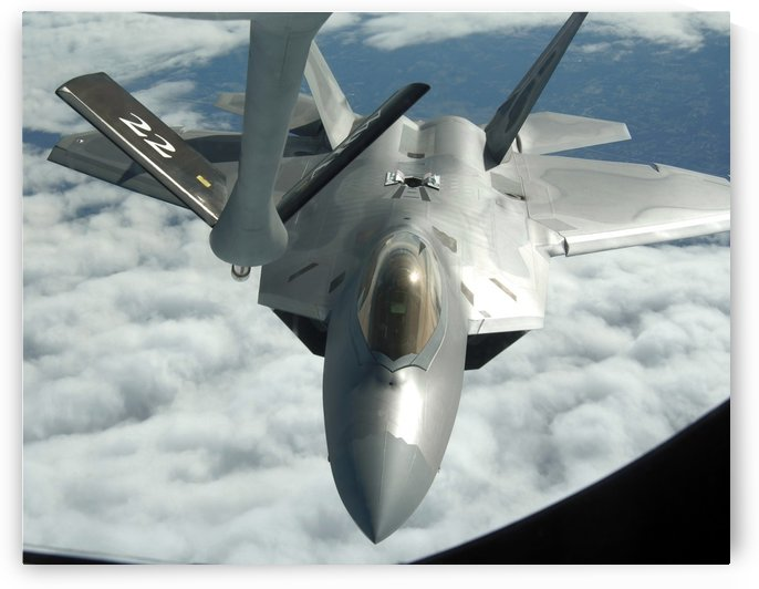 An F-22A Raptor refuels with a KC-135 Stratotanker. by StocktrekImages
