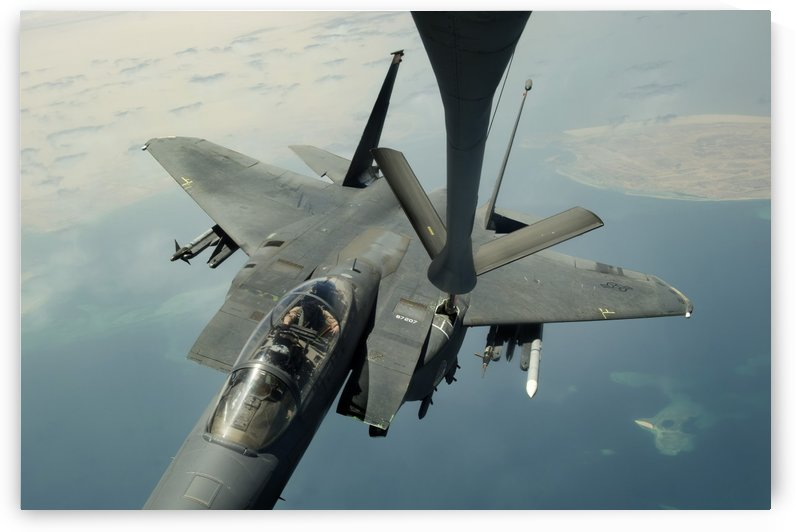 An F-15E Strike Eagle receives fuel from a KC-135R Stratotanker. by StocktrekImages