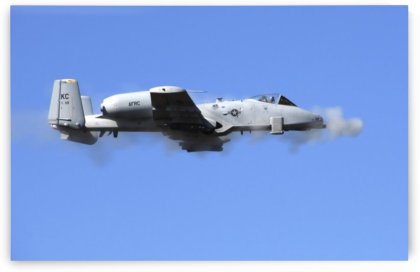 A pilot in an A-10 Thunderbolt II fires the planes 30-mm cannon. by StocktrekImages