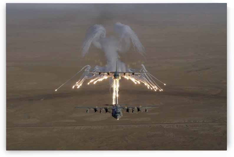 Aerial shot over Iraq of a KC-130 Stratotanker firing flares. by StocktrekImages