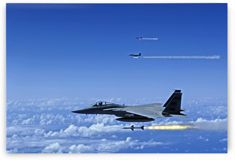 F-15 Eagle aircraft fire AIM-7 Sparrow missiles. by StocktrekImages