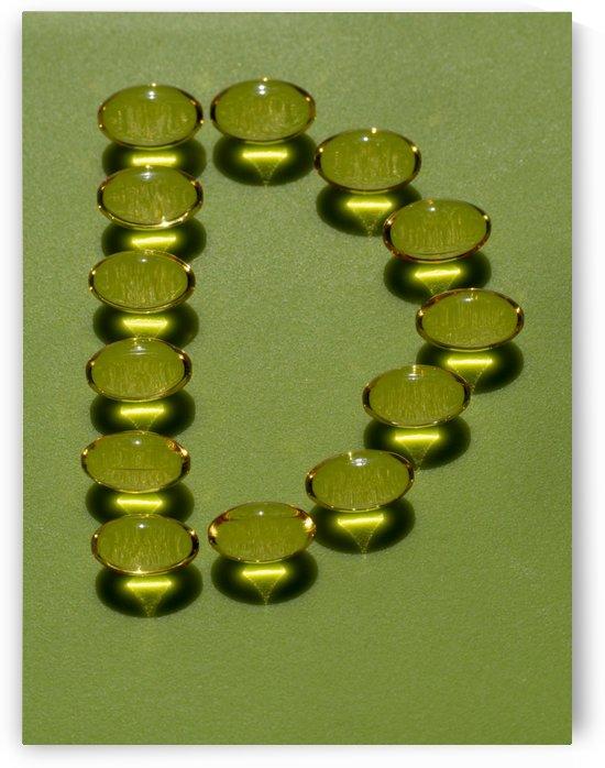 Shiny transparent vitamin d pills D letter. Omega 3 by CiddiBiri