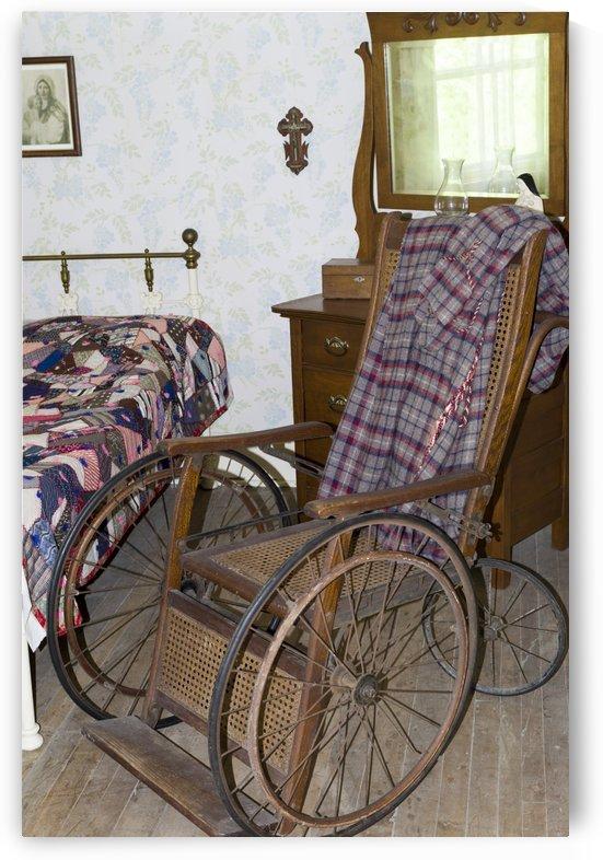 Antique wooden wheel chair by Bob Corson