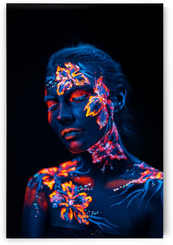 Beautiful flowers in UV light on a young girl face and body by Faces Studio