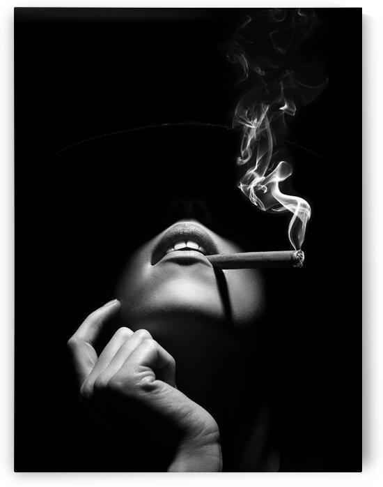 Woman smoking a cigar by Johan Swanepoel