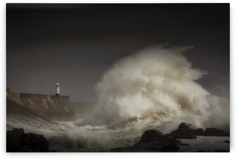 Porthcawl lighthouse and storm wave by Leighton Collins