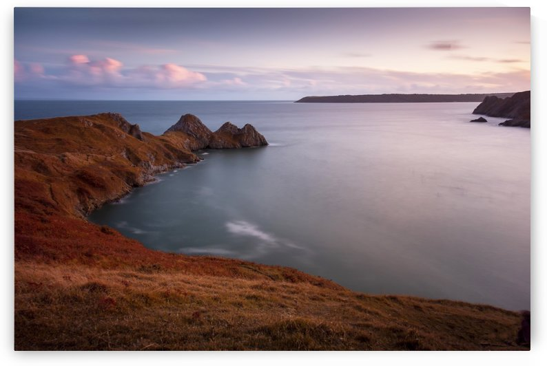 Calm waters at Three Cliffs Bay Gower by Leighton Collins