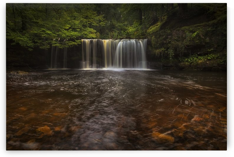 A curtain of water at Sgwd Ddwli Isaf by Leighton Collins