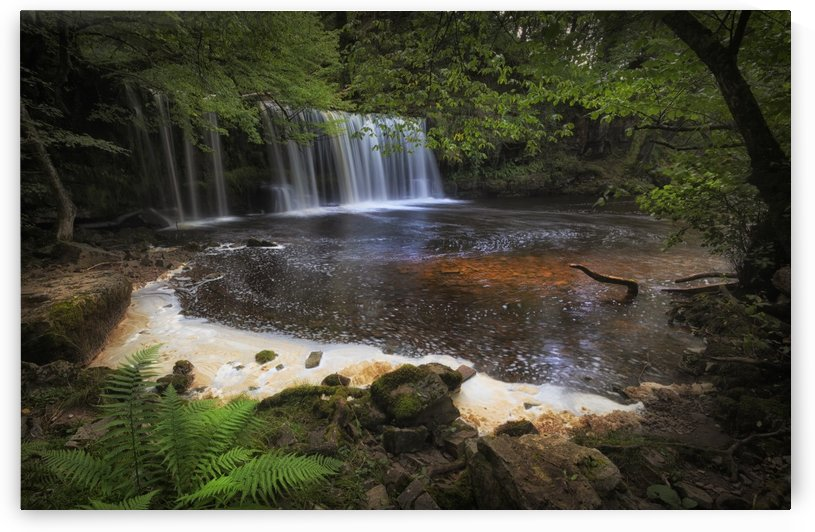 Water and foam at Sgwd Ddwli Isaf waterfall South Wales by Leighton Collins