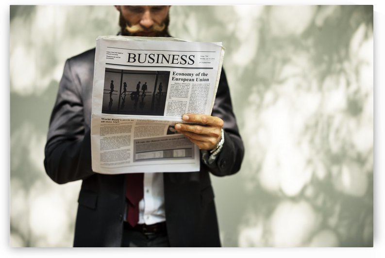 A bearded man reading the business section of a newspaper by Alex Pell